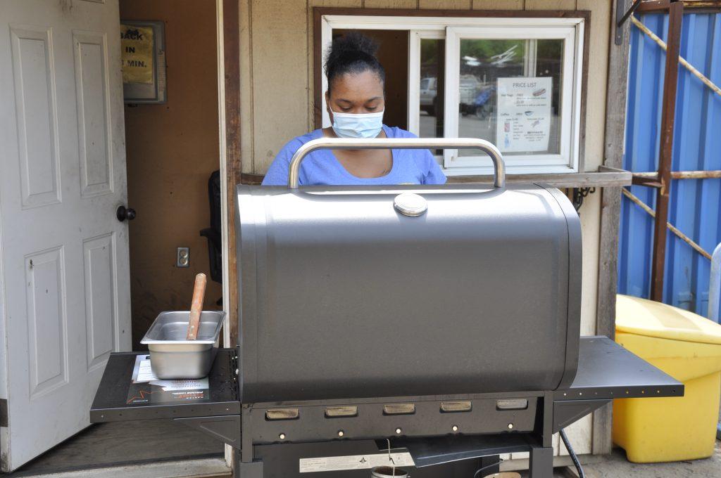 Cooking hotdogs at the hotdog hut.